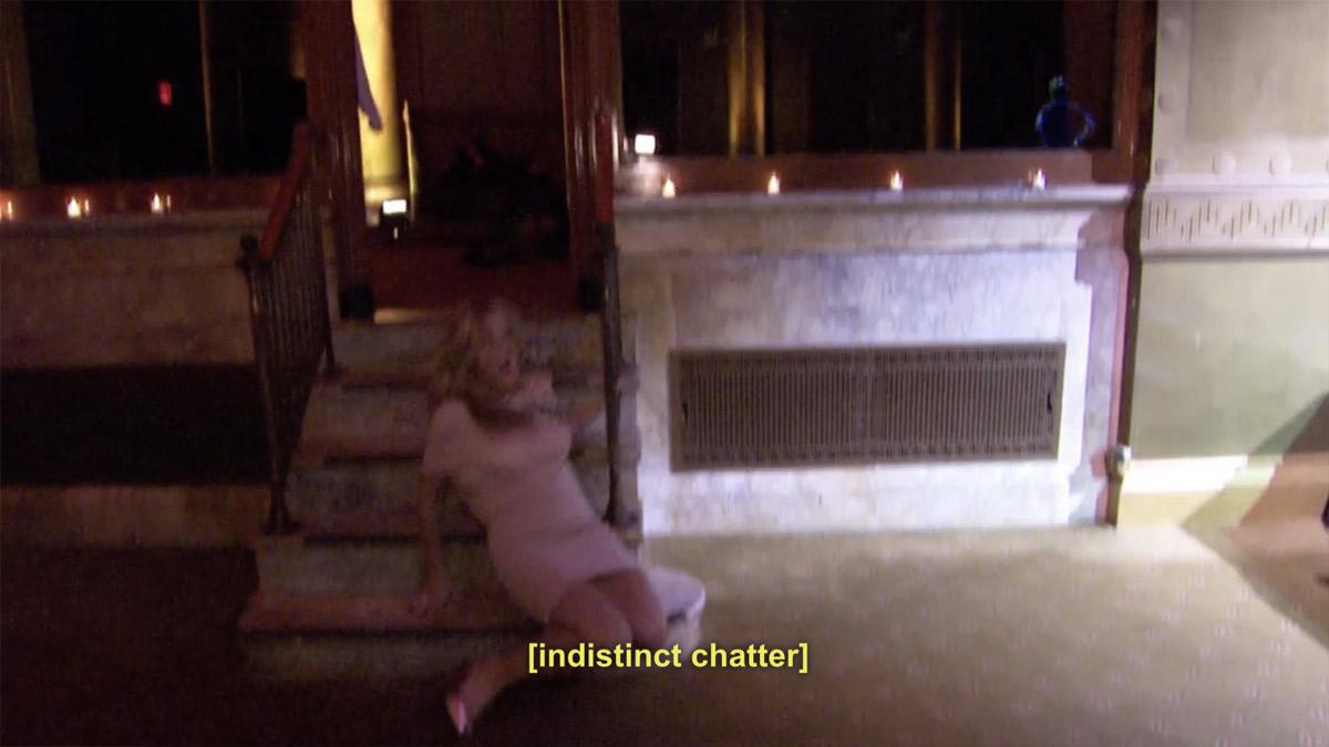 Jessie falls. Indistinct chatter