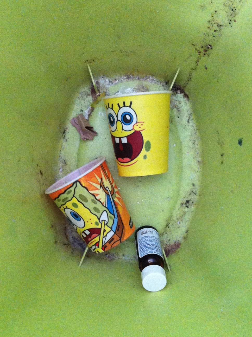 SpongeBob cups in trash.